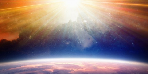 50720486 - bright light from above shines on planet earth. elements of this image furnished by nasa nasa.gov